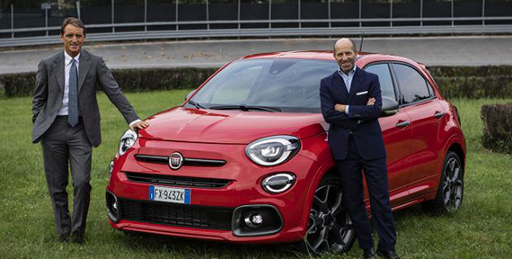 Italy's coach Roberto Mancini discovering in Turin the new Fiat 500X Sport